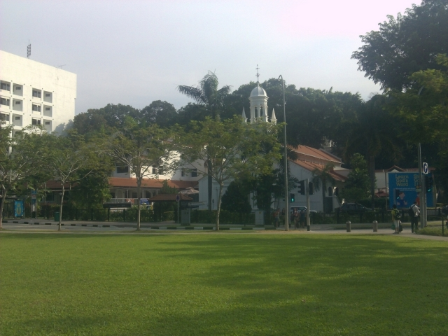 A field and a church approaching Orchard Road