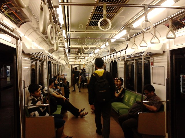 Inside the Jakarta Commuter Line at night