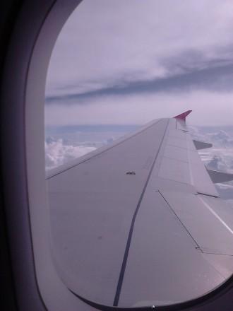Samudera awan dari balik jendela Air Asia