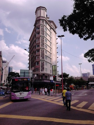 A purple-line GoKL bus passing by