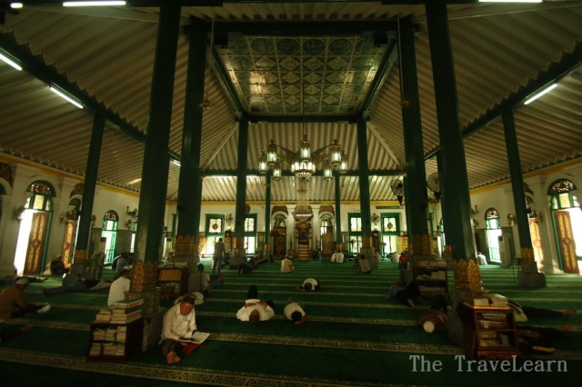 People praying inside the Great Mosque of Palembang