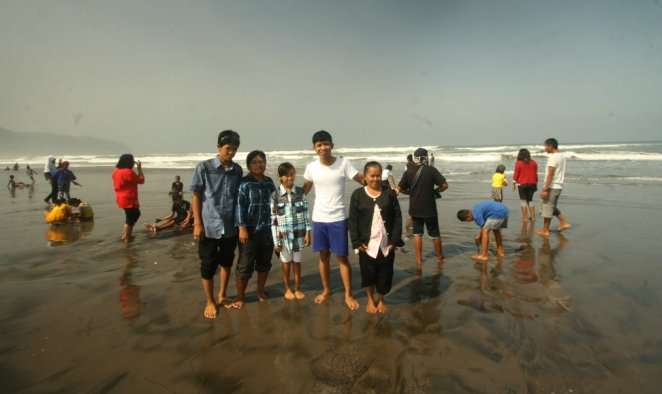 My family and I at Parangtritis Beach, Yogyakarta