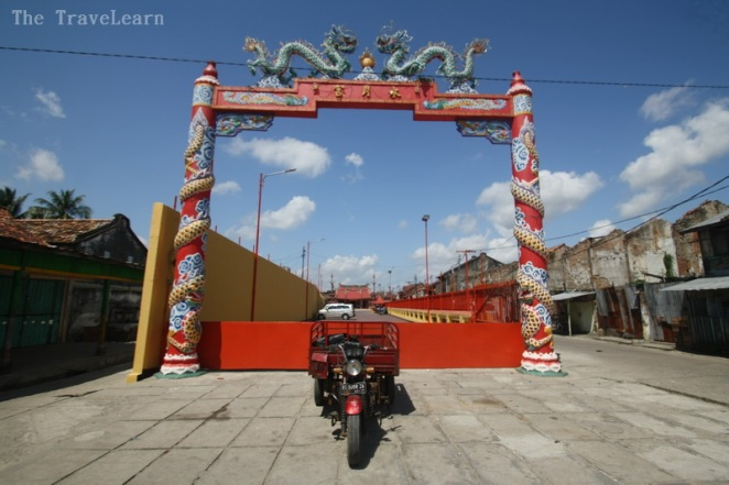 A motorcycle in front of a chinese temple, Palembang