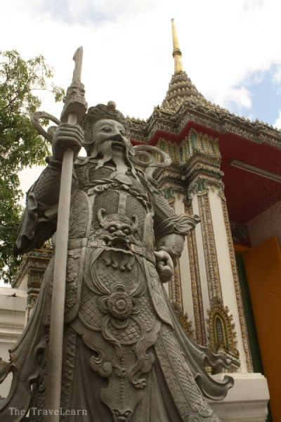 Statue of Buddhist god at the entrance gate