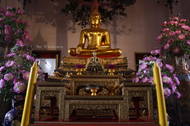 A golden Buddha image inside a viharn of Wat Pho