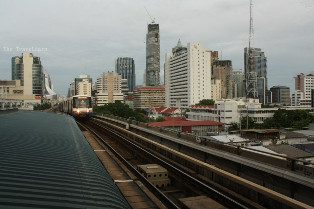 A BTS (Skytrain) is coming toward Saphan Taksin Station
