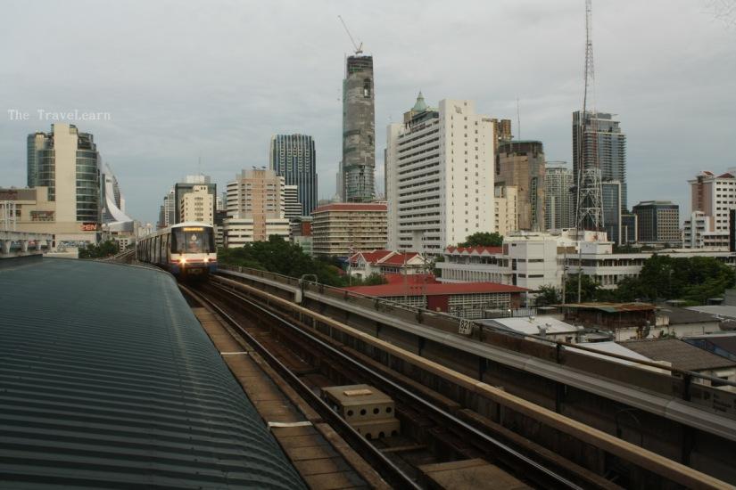 A BTS (Skytrain) is coming toward Saphan Taksin Station
