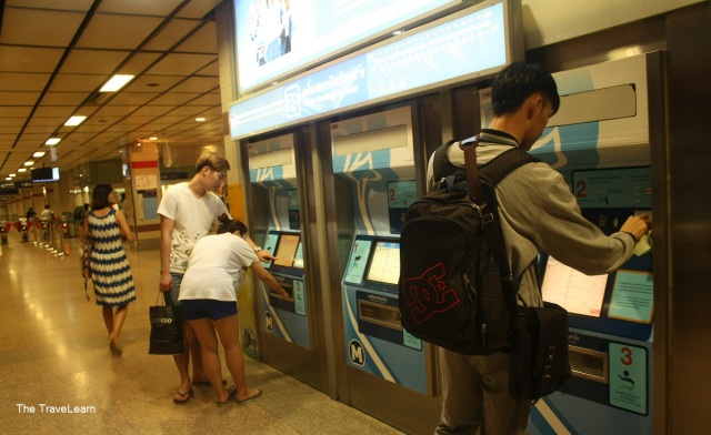 Buying ticket at vending machine