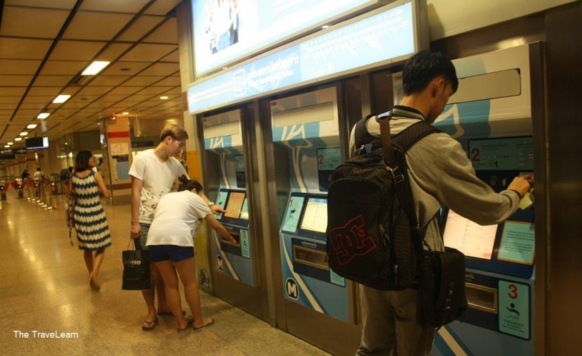 Buying ticket at vending machine