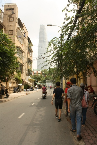 Walking toward the Bitexco Financial Tower