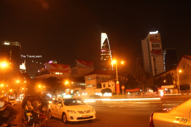 Ho Chi Minh City at night, with Bitexco Financial Tower as the background