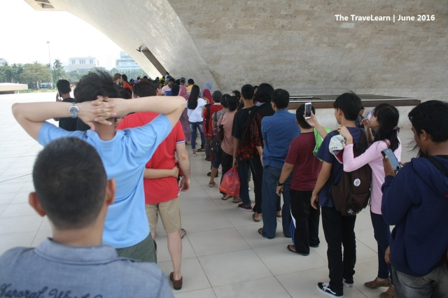 Long queue to enter the elevator in Monumen Nasional (Monas), Jakarta