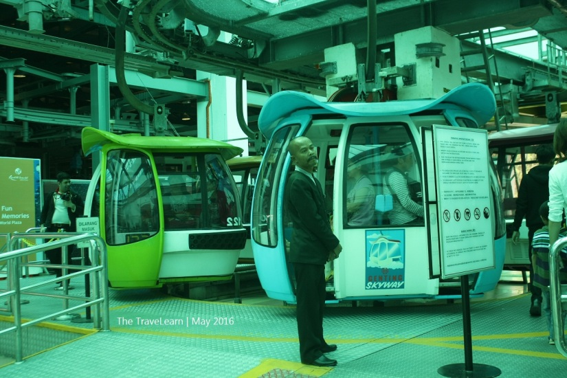 Officer standing next to Genting Skyway Cable Car