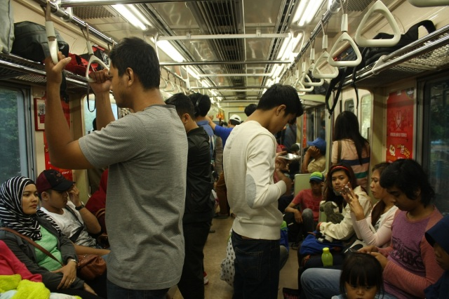 Jakartans inside the coaches